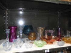 A quantity of coloured glass including vases etc.