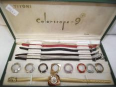 A boxed Titoni colorscope 9 wristwatch with interchangeable bezels and straps