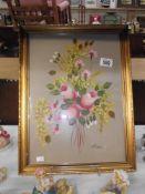 A gilt framed oil on board of Roses signed Rossi