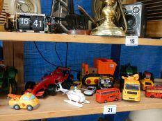 A shelf of die cast models.