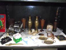 A mixed lot of brassware, plaques, albion bakelite desk calendar etc.