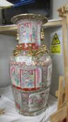 A tall hand painted Chinese vase.