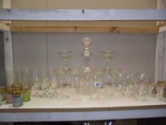 A moulded glass decanter and good selection of vintage drinking glasses