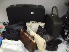 A selection of vintage handbags and suit cases
