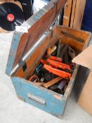 An old pine tool box with tools.