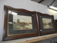 A pair of 1930's framed Dutch scened watercolours in good frames