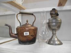 A plated brass oil lamp and a Victorian copper kettle