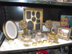 A selection of gilded gold painted picture frames, napkin rings etc.