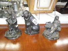 3 bronzed resin ornaments being 2 tramps and a dog.