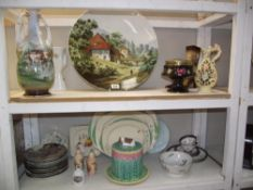 A large continental handpainted charger and other pottery/china including a large cheese keep (2