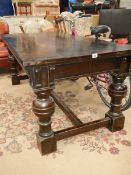 A large dark oak refrectory table.