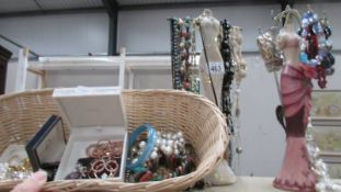 A good selection of costume jewellery on 2 jewellery stands etc.