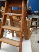 A small pine step ladder.