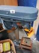 A work bench pedestal drill.