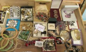 A box of assorted costume jewellery, approximately 40 items.