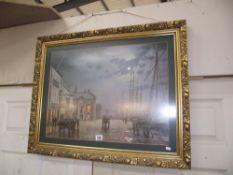 A large gilt framed print of 19c dockside