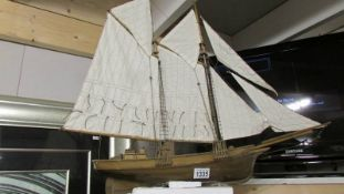 A model sailing boat.
