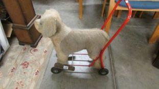 A vintage child's push along dog.