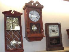 2 modern wall clocks and a mantel clock