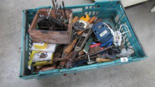 A tray of old tools.