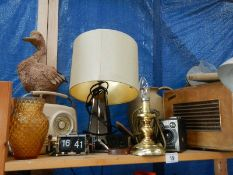 A shelf of radio's, lamp etc.