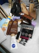 A mixed lot of make up, shoes, hats etc.