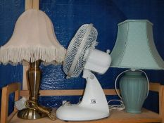 2 table lamps and a desk fan,.