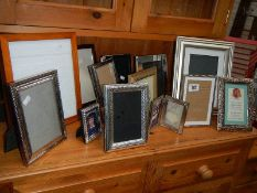 A mixed lot of picture frames including silver plate.