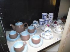 A Langley pottery teaset and selection of floral porcelain cups and saucers etc.