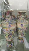 A pair of hand painted Chinese vases, 46 cm tall.