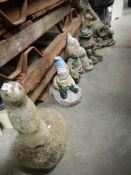 6 Garden gnomes and a quantity of ceramic garden pots.