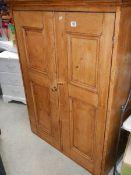 An old pine 2 door cabinet.