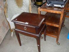 A Lloyd Loom Chair, a tea trolley and a small single drawer table.