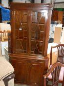 An astragal glazed corner cabinet.