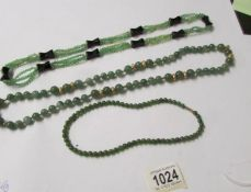 3 good green stone necklaces, 2 are possibly jade.