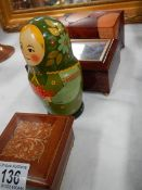 £ boxes and a set of Russian nesting dolls.