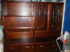 A large mahogany sideboard.