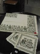 An Austrian table cloth with original tag and 6 matching place mats (in need of cleaning).