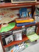 A mixed lot of DVD's, fans etc.