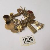 A 9ct gold charm bracelet of 182 grams, including some weight in stones.