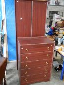 A 5 drawer chest and a matching wardrobe.