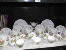 A Regency bone china tea set with hunting scene