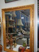 A gilt framed mirror.