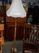 A standard lamp with shade.
