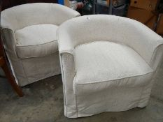 A pair of tub chairs.