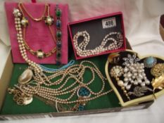 A mixed lot of necklaces, brooches etc.