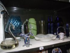 A selection of coloured glass ware including vases and bowls and 3 glass blue bottles