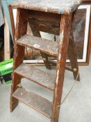 A small old step ladder.