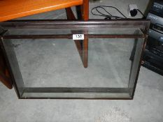 A wall mounting glass frame.