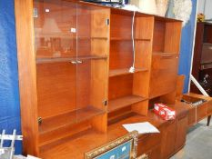A large teak sideboard.